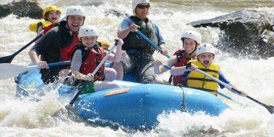 family rafting on river dranse in morzine in french alps