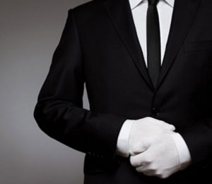 Concierge Service man in black suit white gloves
